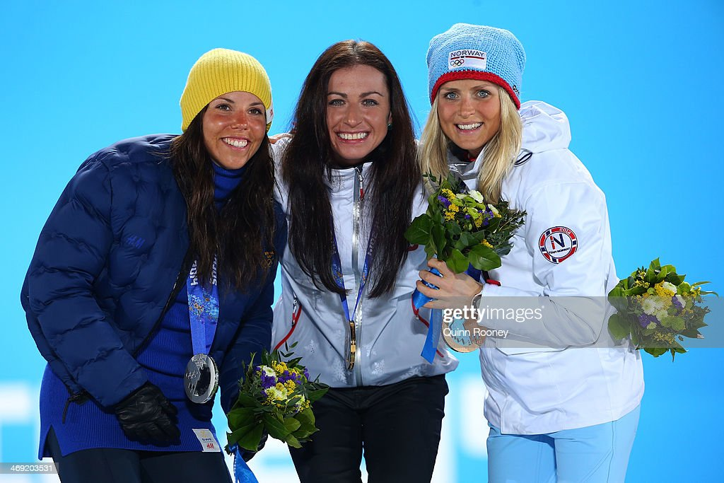 Silver medalist <a gi-track='captionPersonalityLinkClicked' href=/galleries/search?phrase=Charlotte+Kalla&family=editorial&specificpeople=4081474 ng-click='$event.stopPropagation()'>Charlotte Kalla</a> of Sweden, gold medalist Justyna Kowalczyk of Poland and bronze medalist <a gi-track='captionPersonalityLinkClicked' href=/galleries/search?phrase=Therese+Johaug&family=editorial&specificpeople=4176080 ng-click='$event.stopPropagation()'>Therese Johaug</a> of Norway celebrate during the medal ceremony for the Women's 10 km Classic on day six of the Sochi 2014 Winter Olympics at Medals Plaza on February 13, 2014 in Sochi, Russia.