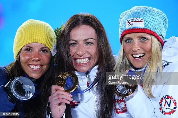 Silver medalist Charlotte Kalla of Sweden gold medalist Justyna Kowalczyk of Poland and bronze medalist Therese Johaug of Norway celebrate during the...