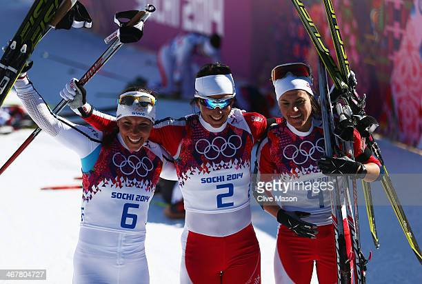 Silver medalist Charlotte Kalla of Sweden gold medalist Marit Bjoergen of Norway and bronze medalist Heidi Weng of Norway celebrate after the Ladies'...