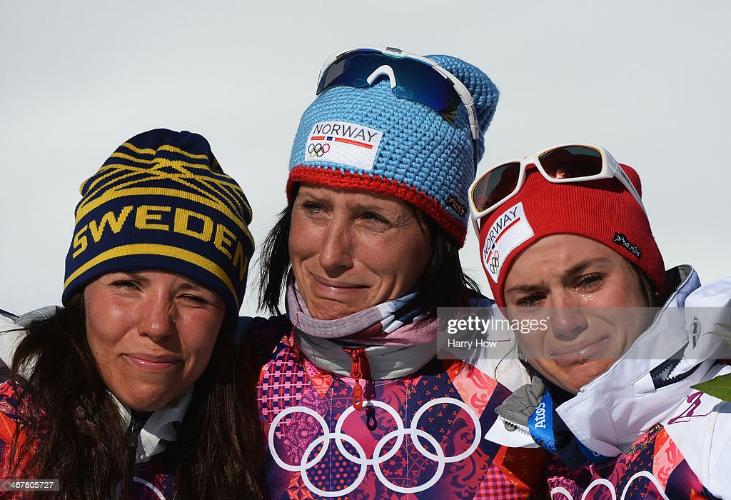 Silver medalist <a gi-track='captionPersonalityLinkClicked' href=/galleries/search?phrase=Charlotte+Kalla&family=editorial&specificpeople=4081474 ng-click='$event.stopPropagation()'>Charlotte Kalla</a> of Sweden, gold medalist <a gi-track='captionPersonalityLinkClicked' href=/galleries/search?phrase=Marit+Bjoergen&family=editorial&specificpeople=216406 ng-click='$event.stopPropagation()'>Marit Bjoergen</a> of Norway and bronze medalist <a gi-track='captionPersonalityLinkClicked' href=/galleries/search?phrase=Heidi+Weng&family=editorial&specificpeople=8660218 ng-click='$event.stopPropagation()'>Heidi Weng</a> of Norway celebrate on the podium during the flower ceremony for the Ladies' Skiathlon 7.5 km Classic + 7.5 km Free during day one of the Sochi 2014 Winter Olympics at Laura Cross-country Ski & Biathlon Center on February 8, 2014 in Sochi, Russia.