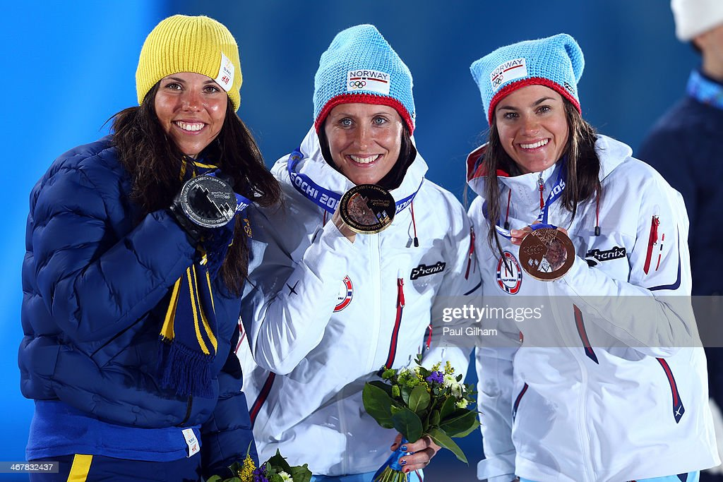 Silver medalist <a gi-track='captionPersonalityLinkClicked' href=/galleries/search?phrase=Charlotte+Kalla&family=editorial&specificpeople=4081474 ng-click='$event.stopPropagation()'>Charlotte Kalla</a> of Sweden, gold medalist <a gi-track='captionPersonalityLinkClicked' href=/galleries/search?phrase=Marit+Bjoergen&family=editorial&specificpeople=216406 ng-click='$event.stopPropagation()'>Marit Bjoergen</a> of Norway and bronze medalist <a gi-track='captionPersonalityLinkClicked' href=/galleries/search?phrase=Heidi+Weng&family=editorial&specificpeople=8660218 ng-click='$event.stopPropagation()'>Heidi Weng</a> of Norway on the podium during the medal ceremony for the for the for the Women's Skiathlon 7.5km Classic & 7.5km Free during day 1 of the Sochi 2014 Winter Olympics at Medals Plaza on February 8, 2014 in Sochi, Russia.