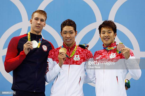 Silver medalist Chase Kalisz of the United States gold medal medalist Kosuke Hagino of Japan and bronze medalist Daiya Seto of Japan pose during the...
