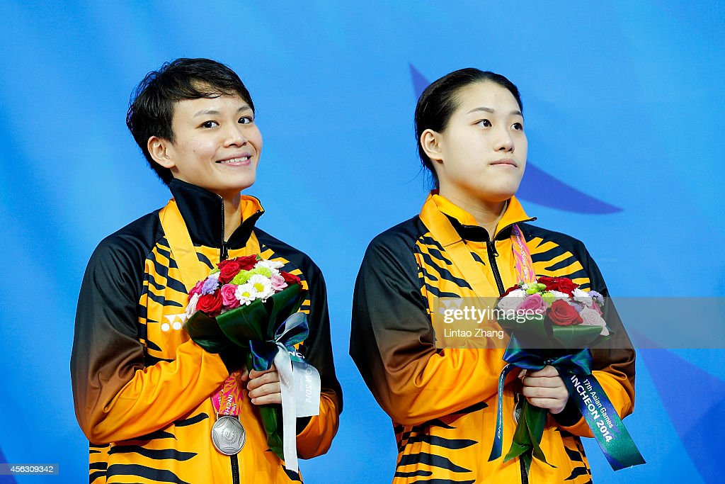 Silver medalist <a gi-track='captionPersonalityLinkClicked' href=/galleries/search?phrase=Cheong+Jun+Hoong&family=editorial&specificpeople=795329 ng-click='$event.stopPropagation()'>Cheong Jun Hoong</a> and Ng Yan Yee of Malaysia celebrates during the medal ceremony after the Women's Synchronised 3m Springboard Final in day ten during the 2014 Asian Games at Munhak Park Tae-hwan Aquatics Center on September 29, 2014 in Incheon, South Korea.