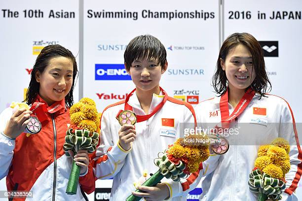 Silver medalist Chihiro Igarashi of Japan and Gold medalist Li Bingjie of China and Bronze medalist Zhang Yuhan of China pose for photographs after...