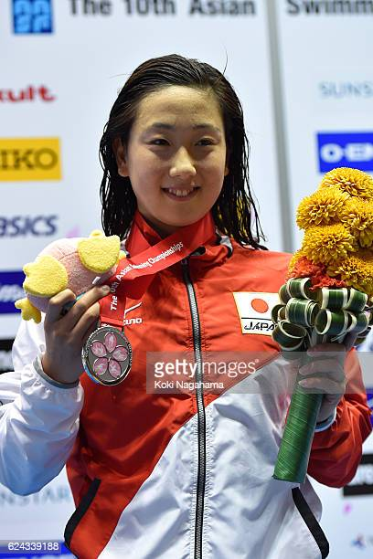 Silver medalist Chihiro Igarashi of Japan poses for photographs after the Women's 400m Freestyle final during the 10th Asian Swimming Championships...