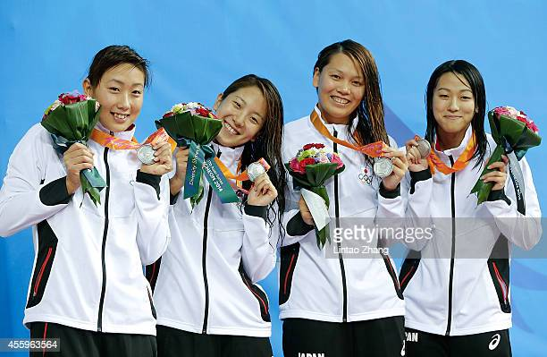 Silver medalist Chihiro Igarashi Yasuko Miyamoto Yayoi Matsumoto and Aya Takano of Japan celebrate winning silver during the medal ceremony after the...