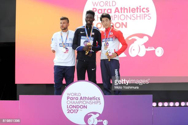Silver medalist Chirstos Koutoulias of Greece gold medalist Tobi Fawehinmi of the United States and bronze medalist Hajimu Ashida of Japan pose on...