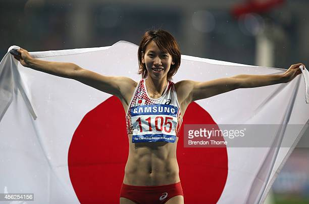 Silver medalist Chisato Fukushima of Japan pose for photographs after competing in the Women's 100m during day nine of the 2014 Asian Games at...