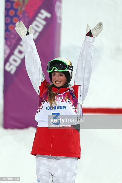 Silver medalist Chloe DufourLapointe of Canada celebrates on the podium during the flower ceremony following the Ladies' Moguls Final 3 on day one of...