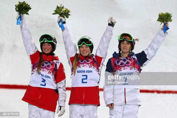 Silver medalist Chloe DufourLapointe of Canada gold medalist Justine DufourLapointe of Canada and bronze medalist Hannah Kearney of the United States...