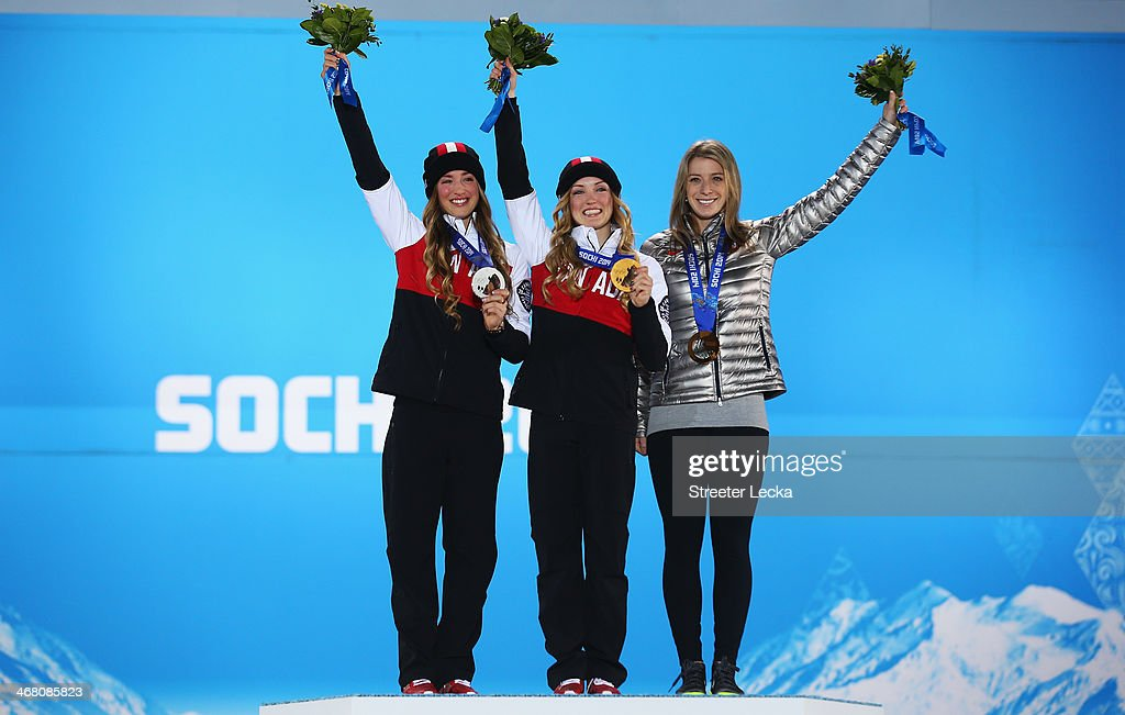 Silver medalist Chloe Dufour-Lapointe of Canada, gold medalist <a gi-track='captionPersonalityLinkClicked' href=/galleries/search?phrase=Justine+Dufour-Lapointe&family=editorial&specificpeople=7469946 ng-click='$event.stopPropagation()'>Justine Dufour-Lapointe</a> of Canada and bronze medalist <a gi-track='captionPersonalityLinkClicked' href=/galleries/search?phrase=Hannah+Kearney&family=editorial&specificpeople=228988 ng-click='$event.stopPropagation()'>Hannah Kearney</a> of the United States pose on the podium during the medal ceremony for the Ladies' Moguls Final 3 on day 2 of the Sochi 2014 Winter Olympics at Medals Plaza on February 9, 2014 in Sochi, .