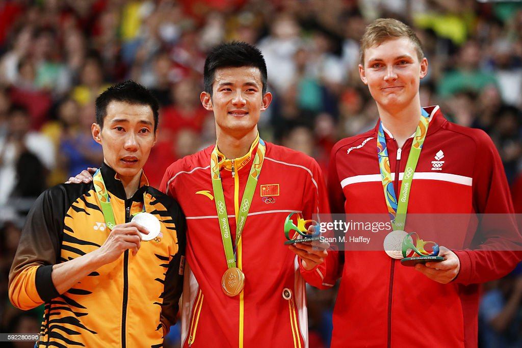 Silver medalist Chong Wei Lee of Malaysia gold medalist Long Chen of China and bronze medalist Viktor Axelson of Denmark pose on the podium during...