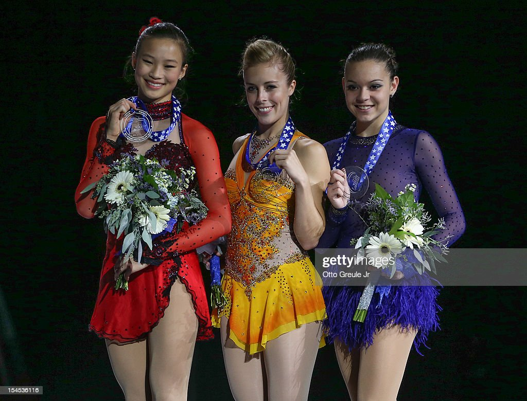 Silver medalist <a gi-track='captionPersonalityLinkClicked' href=/galleries/search?phrase=Christina+Gao&family=editorial&specificpeople=6719493 ng-click='$event.stopPropagation()'>Christina Gao</a>, gold medalist <a gi-track='captionPersonalityLinkClicked' href=/galleries/search?phrase=Ashley+Wagner&family=editorial&specificpeople=2564533 ng-click='$event.stopPropagation()'>Ashley Wagner</a>, and bronze medalist Adelina Sotnikova of Russia pose in the ladies free skate medal ceremony during the Skate America competition at the ShoWare Center on October 21, 2012 in Kent, Washington.