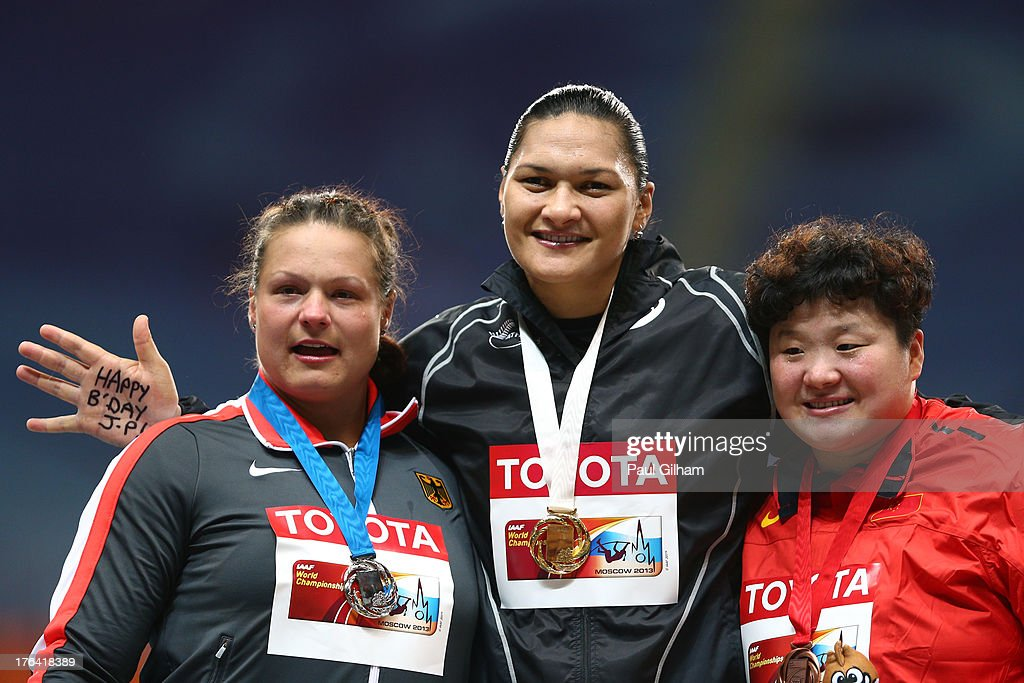 Silver medalist Christina Schwanitz of Germany, Gold medalist <a gi-track='captionPersonalityLinkClicked' href=/galleries/search?phrase=Valerie+Adams&family=editorial&specificpeople=2174723 ng-click='$event.stopPropagation()'>Valerie Adams</a> of New Zealand and bronze medalist <a gi-track='captionPersonalityLinkClicked' href=/galleries/search?phrase=Lijiao+Gong&family=editorial&specificpeople=4472722 ng-click='$event.stopPropagation()'>Lijiao Gong</a> of China on the podium during the medal ceremony for the Women's Shot Put during Day Three of the 14th IAAF World Athletics Championships Moscow 2013 at Luzhniki Stadium on August 12, 2013 in Moscow, Russia.