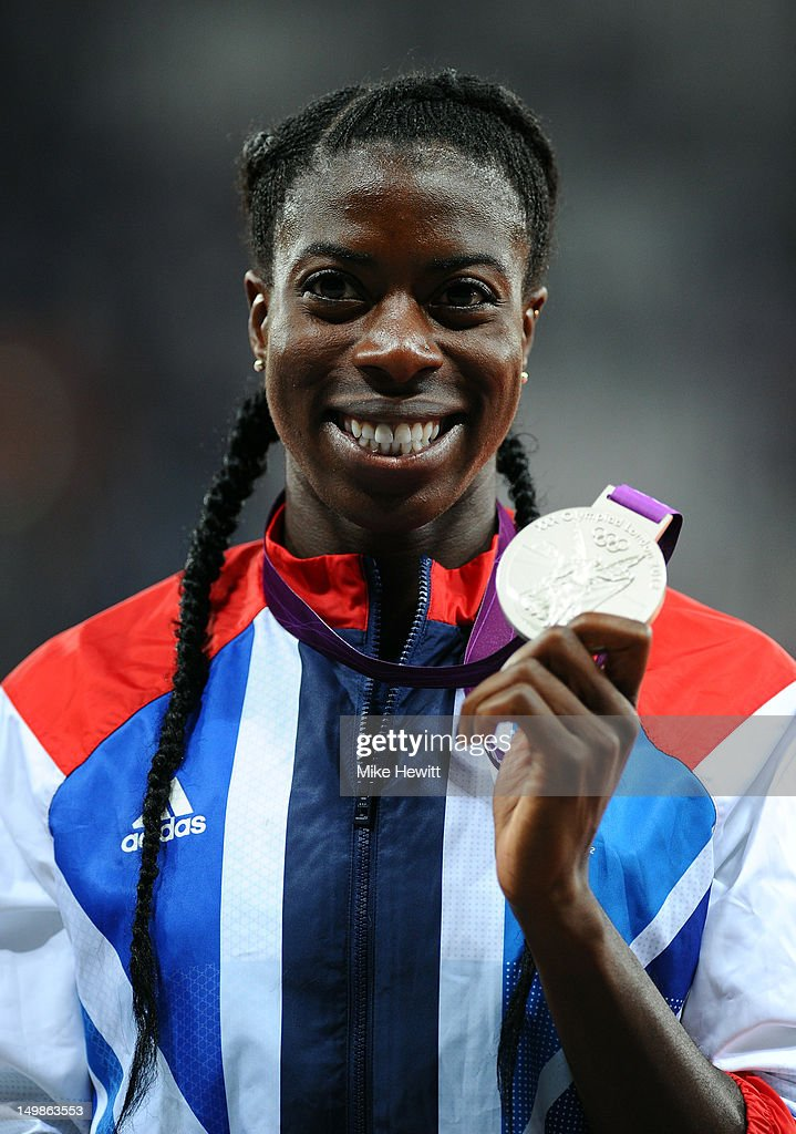 Silver medalist <a gi-track='captionPersonalityLinkClicked' href=/galleries/search?phrase=Christine+Ohuruogu&family=editorial&specificpeople=703549 ng-click='$event.stopPropagation()'>Christine Ohuruogu</a> of Great Britain poses on the podium during the medal ceremony for the Women's 400m Final on Day 9 of the London 2012 Olympic Games at the Olympic Stadium on August 5, 2012 in London, England.