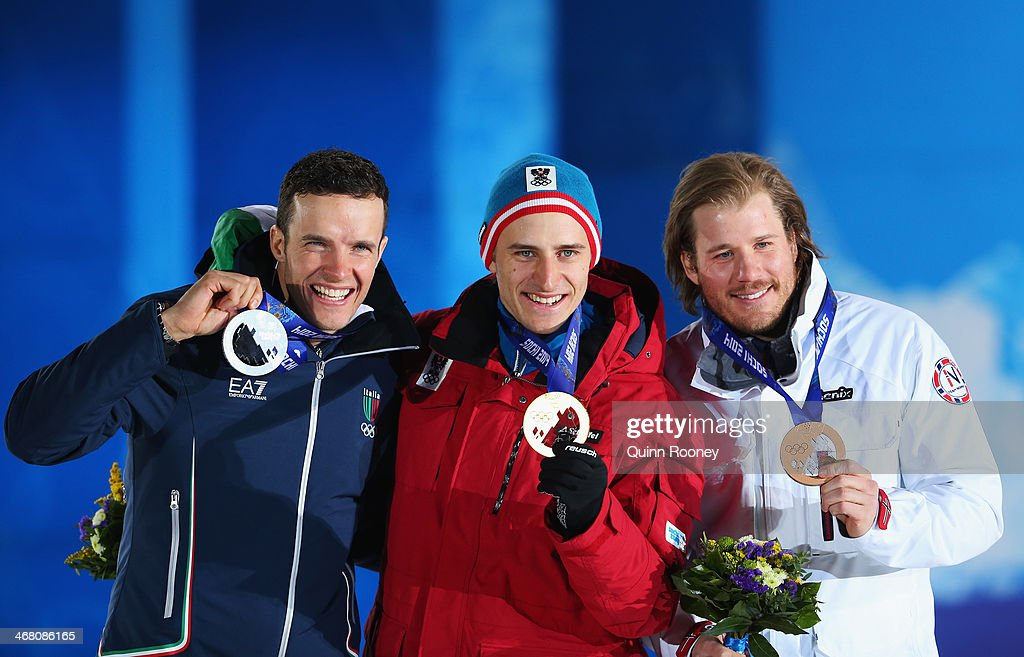 Silver medalist <a gi-track='captionPersonalityLinkClicked' href=/galleries/search?phrase=Christof+Innerhofer&family=editorial&specificpeople=4104734 ng-click='$event.stopPropagation()'>Christof Innerhofer</a> of Austria, gold medalist Matthias Mayer of Austria and bronze medallist <a gi-track='captionPersonalityLinkClicked' href=/galleries/search?phrase=Kjetil+Jansrud&family=editorial&specificpeople=816480 ng-click='$event.stopPropagation()'>Kjetil Jansrud</a> of Norway celebrate on the podium during the medal ceremony for the Alpine Skiing Men's Downhill on day 2 of the Sochi 2014 Winter Olympics at Medals Plaza on February 9, 2014 in Sochi, .