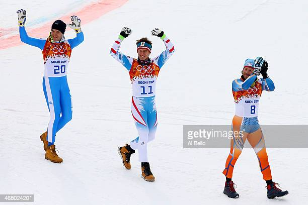 Silver medalist Christof Innerhofer of Italy gold medalist Matthias Mayer of Austria and bronze medalist Kjetil Jansrud of Norway approach the podium...