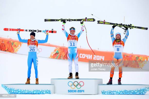 Silver medalist Christof Innerhofer of Italy gold medalist Matthias Mayer of Austria and bronze medalist Kjetil Jansrud of Norway stand on the podium...
