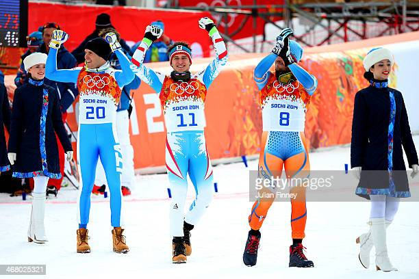 Silver medalist Christof Innerhofer of Italy gold medalist Matthias Mayer of Austria and bronze medalist Kjetil Jansrud of Norway make their way the...