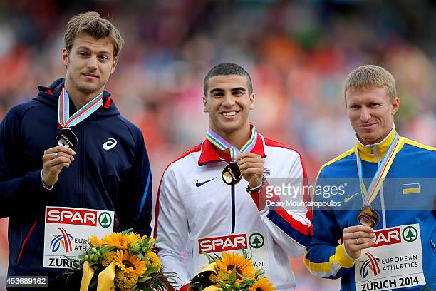 Silver medalist Christophe Lemaitre of France gold medalist Adam Gemili of Great Britain and Northern Ireland and Serhiy Smelyk of Ukraine celebrate...