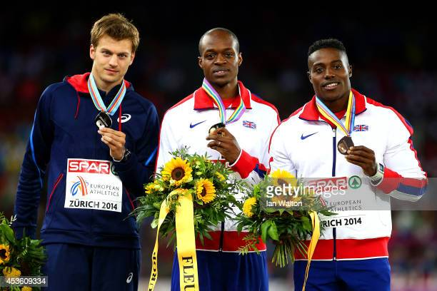 Silver medalist Christophe Lemaitre of France gold medalist James Dasaolu of Great Britain and Northern Ireland and bronze medalist Harry...