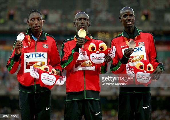 Silver medalist Conseslus Kipruto of Kenya gold medalist Ezekiel Kemboi of Kenya and bronze medalist Brimin Kiprop Kipruto of Kenya pose on the...
