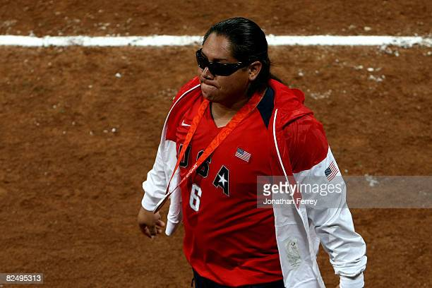 Silver medalist Crystl Bustos of the United States walks off the field after she left her spikes at home plate after USA lost 31 to Japan during the...