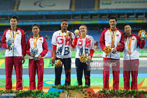 Silver medalist Cuiqing Liu of China with her guide Dangling Xu gold medalist Libby Clegg of Great Britain and her guide Chris Clarke and bronze...
