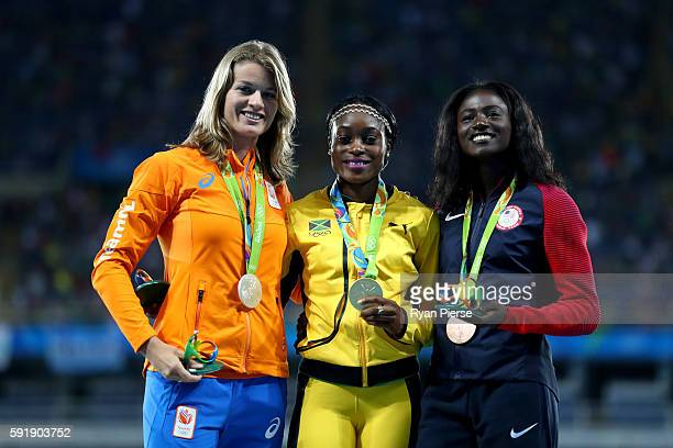 Silver medalist Dafne Schippers of the Netherlands gold medalist Elaine Thompson of Jamaica and bronze medalist Tori Bowie of the United States pose...