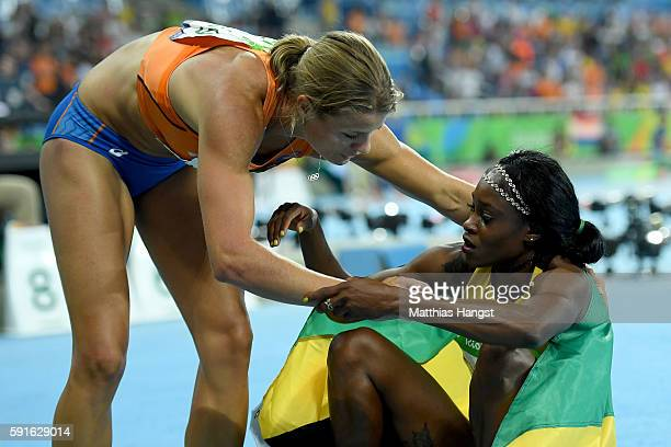 Silver medalist Dafne Schippers of the Netherlands greets gold medalist Elaine Thompson of Jamaica after the Women's 200m Final on Day 12 of the Rio...