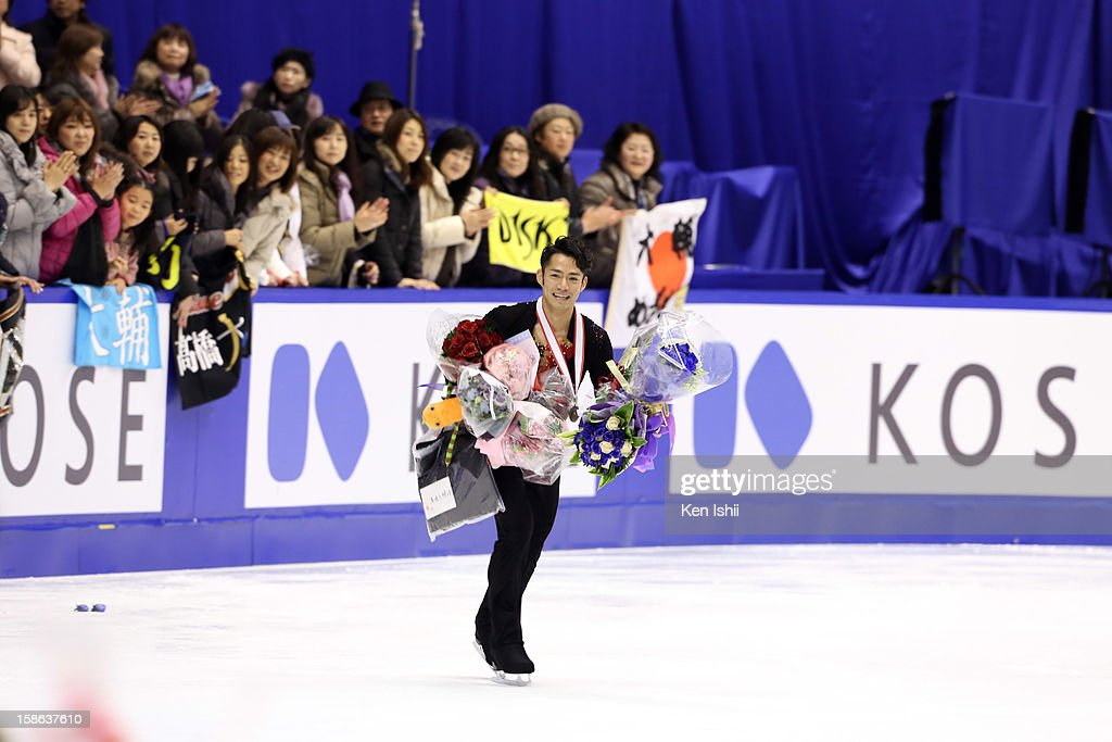 Silver medalist <a gi-track='captionPersonalityLinkClicked' href=/galleries/search?phrase=Daisuke+Takahashi&family=editorial&specificpeople=725172 ng-click='$event.stopPropagation()'>Daisuke Takahashi</a> greets fans after competing during day two of the 81st Japan Figure Skating Championships at Makomanai Sekisui Heim Ice Arena on December 22, 2012 in Sapporo, Japan.