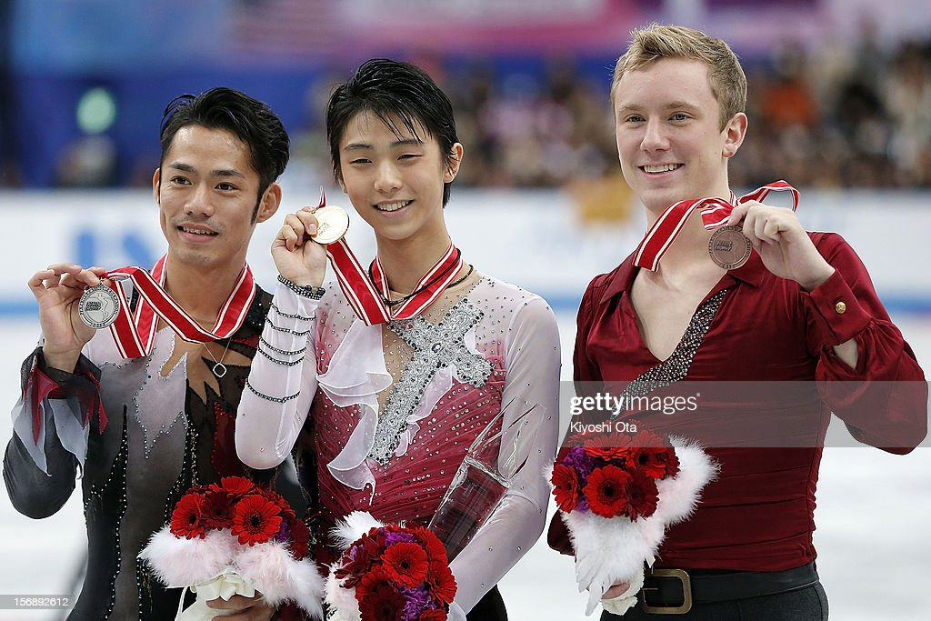 Silver medalist Daisuke Takahashi of Japan, gold medalist Yuzuru Hanyu of Japan and bronze medalist Ross Miner of the United States pose for photographs at the medal ceremony after the Men competition during day two of the ISU Grand Prix of Figure Skating NHK Trophy at Sekisui Heim Super Arena on November 24, 2012 in Rifu, Japan.