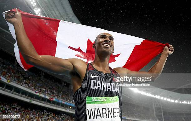 Silver medalist Damian Warner of Canada celebrates after the Men's Decathlon 1500m on Day 13 of the Rio 2016 Olympic Games at the Olympic Stadium on...