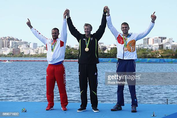 Silver medalist Damir Martin of Croatia gold medalist Mahe Drysdale of New Zealand and bronze medalist Ondrej Synek of the Czech Republic pose on the...