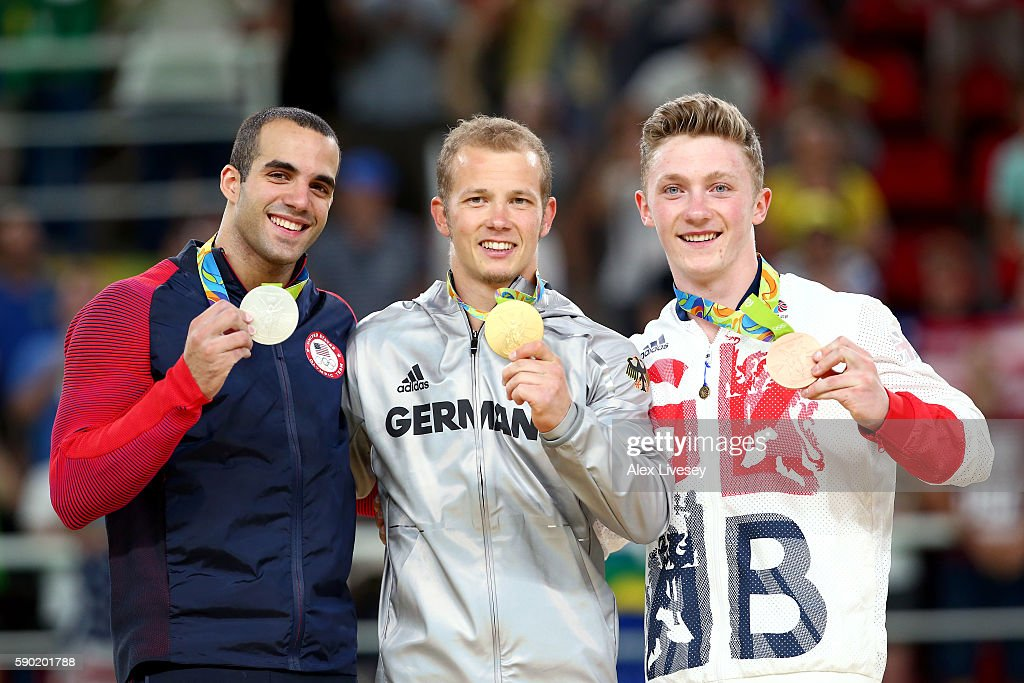 Silver medalist Danell Leyva of the United States gold medalist Fabian Hambuechen of Germany and bronze medalist Nile Wilson of Great Britain pose...