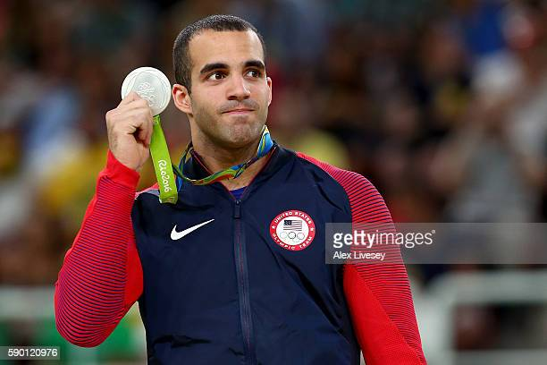 Silver medalist Danell Leyva of the United States poses for photographs at the medal ceremony for the Parallel Bars on Day 11 of the Rio 2016 Olympic...