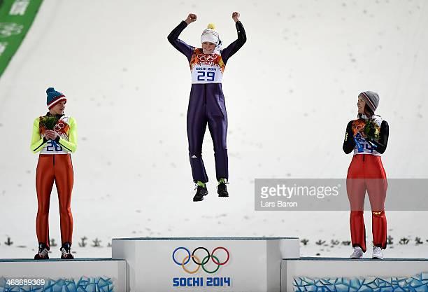 Silver medalist Daniela IraschkoStolz of Austria gold medalist Carina Vogt of Germany and bronze medalist Coline Mattel of France on the podium...