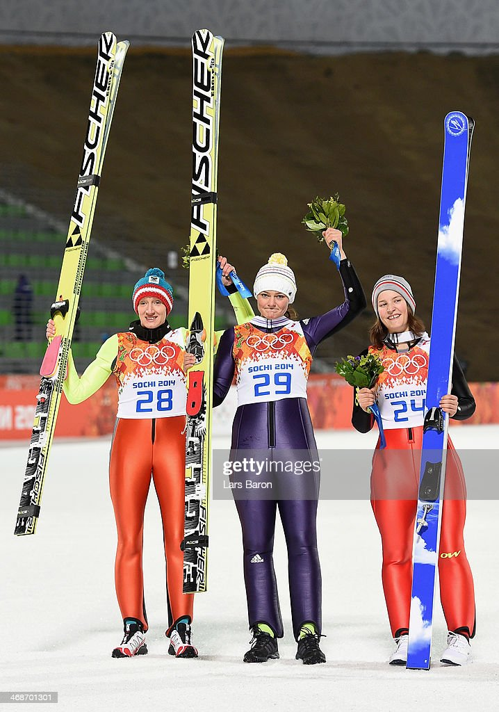 Silver medalist <a gi-track='captionPersonalityLinkClicked' href=/galleries/search?phrase=Daniela+Iraschko-Stolz&family=editorial&specificpeople=5719068 ng-click='$event.stopPropagation()'>Daniela Iraschko-Stolz</a> of Austria, gold medalist <a gi-track='captionPersonalityLinkClicked' href=/galleries/search?phrase=Carina+Vogt&family=editorial&specificpeople=4596006 ng-click='$event.stopPropagation()'>Carina Vogt</a> of Germany and bronze medalist <a gi-track='captionPersonalityLinkClicked' href=/galleries/search?phrase=Coline+Mattel&family=editorial&specificpeople=5719079 ng-click='$event.stopPropagation()'>Coline Mattel</a> of France pose for photographs after the flower ceremony for the Ski Jumping Ladies Normal Hill Individual on day 4 of the Sochi 2014 Winter Olympics at the RusSki Gorki Ski Jumping Center on February 11, 2014 in Sochi, Russia.