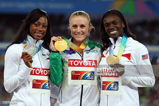 Silver medalist Danielle Carruthers of United States gold medalist Sally Pearson of Australia and bronze medalist Dawn Harper of United States...