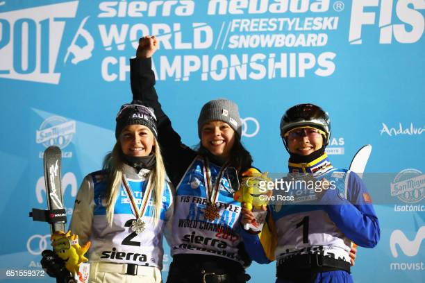 R Silver medalist Danielle Scott of Australia gold medalist Ashley Caldwell of the United States and bronze medalist Mengtao Xu of China celebrate...