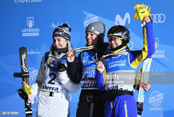 Silver medalist Danielle Scott of Australia gold medalist Ashley Caldwell of the United States and bronze medalist Mengtao Xu of China celebrate...