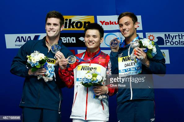 Silver medalist David Boudia of the United States gold medalist Bo Qiu of China and bronze medalist Tom Daley of Great Britain pose with the medals...