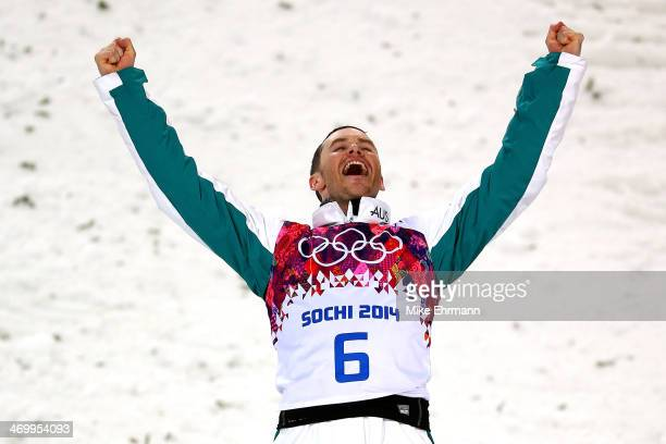 Silver medalist David Morris of Australia celebrates during the flower ceremony for the Freestyle Skiing Men's Aerials Finals on day ten of the 2014...