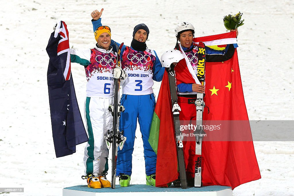 Silver medalist David Morris of Australia, gold medalist <a gi-track='captionPersonalityLinkClicked' href=/galleries/search?phrase=Anton+Kushnir&family=editorial&specificpeople=869347 ng-click='$event.stopPropagation()'>Anton Kushnir</a> of Belarus and bronze medalist <a gi-track='captionPersonalityLinkClicked' href=/galleries/search?phrase=Jia+Zongyang&family=editorial&specificpeople=6744922 ng-click='$event.stopPropagation()'>Jia Zongyang</a> of China celebrate on the podium during the flower ceremony for the Freestyle Skiing Men's Aerials Finals on day ten of the 2014 Winter Olympics at Rosa Khutor Extreme Park on February 17, 2014 in Sochi, Russia.