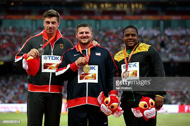Silver medalist David Storl of Germany gold medalist Joe Kovacs of the United States and bronze medalist O'Dayne Richards of Jamaica pose on the...