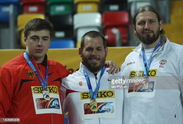 Silver medalist David Storl of Germany gold medalist Ryan Whiting of the United States and bronze medalist Tomasz Majewski of Poland stand on the...