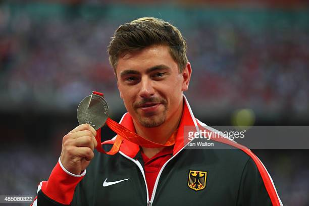 Silver medalist David Storl of Germany poses on the podium during the medal ceremony for the Men's Shot Put final during day three of the 15th IAAF...