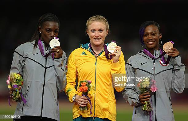 Silver medalist Dawn Harper of the United States gold medalist Sally Pearson of Australia and bronze medalist Kellie Wells of the United States pose...