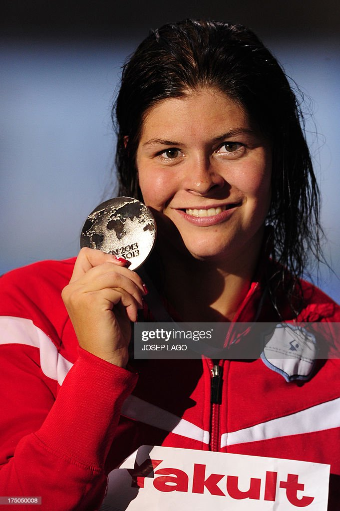 Silver medalist Denmark's <a gi-track='captionPersonalityLinkClicked' href=/galleries/search?phrase=Lotte+Friis&family=editorial&specificpeople=3035975 ng-click='$event.stopPropagation()'>Lotte Friis</a> celebrates on the podium during the award ceremony of the women's 1500 m freestyle swimming event in the FINA World Championships at Palau Sant Jordi in Barcelona on July 30, 2013.