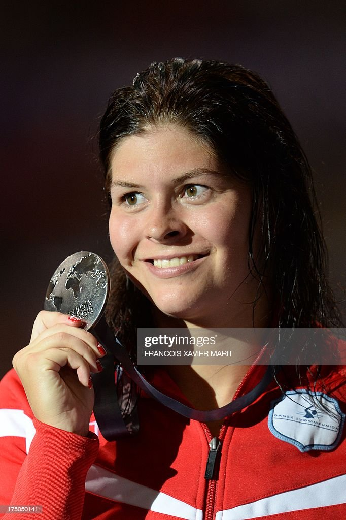 Silver medalist Denmark's <a gi-track='captionPersonalityLinkClicked' href=/galleries/search?phrase=Lotte+Friis&family=editorial&specificpeople=3035975 ng-click='$event.stopPropagation()'>Lotte Friis</a> poses on the podium with her medal during the award ceremony of the women's 1500 m freestyle swimming event in the FINA World Championships at Palau Sant Jordi in Barcelona on July 30, 2013.